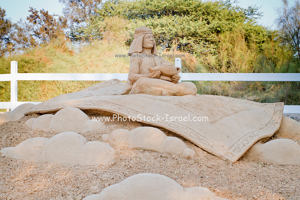 Aladdin on his magic carpet from the Book of One Thousand and One Nights. Sand Sculpture