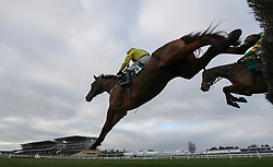 Lostintranslation ridden by Robbie Power jumps with Defi Du Seuil ridden by Barry Geraghty in the Betbright Dipper Novices' Chase during the New Year Meeting at Cheltenham Racecourse.