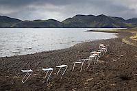 Stólar í röð við Langasjó. Camping chairs by lake Langisjor.