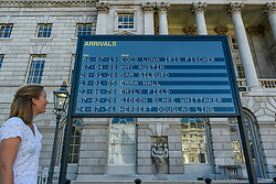 © Licensed to London News Pictures. 10/09/2020. LONDON, UK.  A staff member views Arrivals + Departures, a major interactive installation in the courtyard of Somerset House by Yara and Davina.  The artwork allows the public to memorialise their names on the mechanical flipboards which are often seen at a railway station or airport and is on show until 10 October 2020.  Photo credit: Stephen Chung/LNP