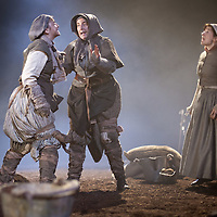 """Picture shows :  (l-r)  Jayd Johnson as Liza, Wendy Seager as Sara Pauline Lockhart as Maggie and (far right).<br /> Bondagers <br /> By Sue Glover<br /> Directed by Lu Kemp<br /> """"Redd up the stables, muck out the byre, plant the tatties, howk the tatties, clamp the tatties... Shear, stook, striddle, stack. Women's work.""""<br /> A true classic of modern Scottish Theatre, and a haunting evocation of a lost way of life, Sue Glover's lyrical play with music and song follows six women land workers as they graft and dance their way through a year on a 19th Century Borders farm.<br /> Every ploughman had to provide a woman (a bondager) to work on the farm. If his wife was too busy with family, he hired a woman to work the fields and lodge in his home. Following these womenthrough the passing of the seasons, we feel the rhythm of the land and the harshness, humour, hope and tragedy of those who worked upon it.<br /> Picture : Drew Farrell<br /> Tel : 07721 -735041<br /> www.drewfarrell.com<br /> <br /> <br /> For Further information please contact Michelle Mangan Press and PR Manager, Royal Lyceum Theatre Edinburgh <br /> Main Line: 0131 248 4800