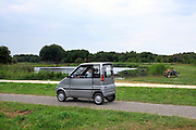 Dutch little handicap car driving in nature park near Amsterdam Holland