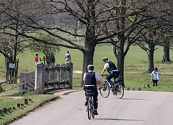 © Licensed to London News Pictures. 11/04/2020. London, UK. A Police cyclists patrolling Richmond Park during the coronavirus disease pandemic. Londoners have been told to stay at home and only leave homes to exercise or when absolutely essential in an attempt to fight the spread of COVID-19 as temperatures for the Easter Bank holiday weekend are expected to reach 26c. Photo credit: Alex Lentati/LNP