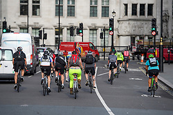© London News Pictures. 25/08/2016. The majority of cyclists ignore the cycle lane (pictured right) on Parliament Square in Westminster, London. Cyclists repeatedly ignore new cycle lanes installed around westminster in central London. Between the hours of 8am and 9am on Wednesday 24/08/2016, 266 (two hundred and sixty six) cyclists passed through the red light at one of the newly installed bike lanes and only 15 (fifteen) cyclists stopped.  The light system is designed to allow either vehicles or cyclists to pass at one time in order to make the junction safer for cyclists..... **VIDEO AVAILABLE** Photo credit: London News Pictures.