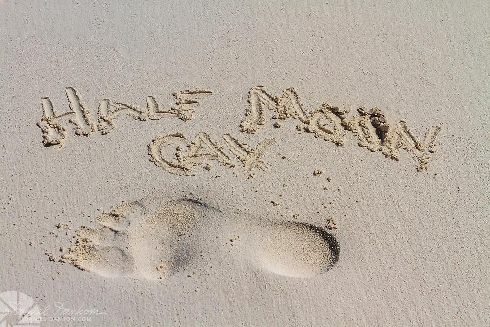 "Half Moon Cay, beach, Bahamas, footprint in the sand and hand drawn text, ""Half Moon Cay"""