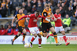 Jonathan Kodjia of Bristol City challenges for the ball with Michael Dawson of Hull City - Mandatory by-line: Dougie Allward/JMP - 02/04/2016 - FOOTBALL - KC Stadium - Hull, England - Hull City v Bristol City - Sky Bet Championship