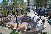 Fountain and palm trees in Plaza de Espana, Vejer de la Frontera, Cadiz Province, Spain