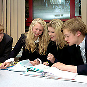 Teenage pupils enjoying a lesson at Ampleforth College, North Yorkshire, UK. Ampleforth College is a coeducational independent day and boarding school in the village of Ampleforth, North Yorkshire, England. It opened in 1802 as a boys' school, and is run by the Benedictine monks and lay staff of Ampleforth Abbey.