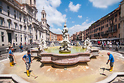 Workers clean an empty fountain in Navona square on July 28, 2017 in Rome, Italy. Rome has suffered from worsening drought since March so as of tomorrow the municipality has decided to take action and ration the distribution of water to citizens, with 8 hour delivery blocks to each area. ©Simone Padovani