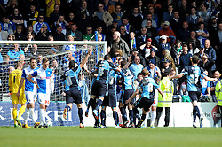 Wycombe Wanderers' Matt McClure celebrates with his team mates after scoring. - Photo mandatory by-line: Dougie Allward/JMP - Mobile: 07966 386802 26/04/2014 - SPORT - FOOTBALL - High Wycombe - Adams Park - Wycombe Wanderers v Bristol Rovers - Sky Bet League Two