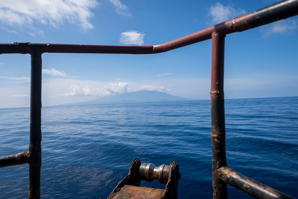 View of Karkar Island from the bow of the the M.V. Thomson, a small cargo and passenger vessel that connects Madang and Karkar Island in Papua New Guinea.<br /> <br /> (August 8, 2017)