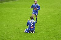 FOTBALL, 15062003, ALFHEIM, TROMSØ/ TIL-LYN/    / PER EGIL SWIFT, LYN,  SITTENDE ETTER 0-1 SCORING. DEREK SØRENSEN KOMMER LØPENDE<br /> FOTO: KAJA BAARDSEN/DIGITALSPORT