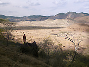Maasai tribesman looking out over the Chyulu Hills, Chyulu Hills National Park, Kenya