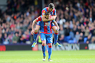 Scott Dann of Crystal Palace leaps onto Damien Delaney of Crystal Palace after the final whistle as Crystal Palace win their 1st match of 2016. Barclays Premier League match, Crystal Palace v Norwich city at Selhurst Park in London on Saturday 9th April 2016. pic by John Patrick Fletcher, Andrew Orchard sports photography.