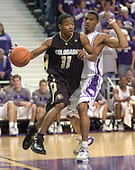 Colorado guard Dominique Coleman (11) drives against pressure from Kansas State's Lance Harris (R) during the first half of the Wildcats 72-60 win over the Buffaloes at Bramalage Coliseum in Manhattan, Kansas, February 18, 2006.
