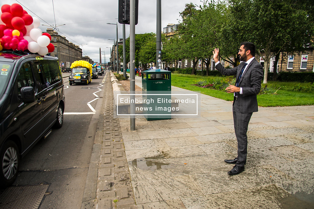 Pictured: Humza Yousef caught caught up in the fun of the annual taxi drivers charity trip to the seaside with the youngsters not standing on ceremony and soack the minister with water bombs and water pistols<br /> <br /> Transport Minister Humza Yousaf launched the second phase of Switched on Scotland when he visited J & E Shepherd Chartered Surveyors today.  During the visit Mr Yousaf saw how the business is benefiting from adopting electric vehicles via the Low Carbon Transport Loan Fund, as he announced an additional GBP8.2 million to support the purchase of low-carbon vehicles. <br /> <br /> Ger Harley | EEm 13 June  2017