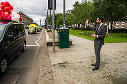 Pictured: Humza Yousef caught caught up in the fun of the annual taxi drivers charity trip to the seaside with the youngsters not standing on ceremony and soack the minister with water bombs and water pistols<br /> <br /> Transport Minister Humza Yousaf launched the second phase of Switched on Scotland when he visited J & E Shepherd Chartered Surveyors today.  During the visit Mr Yousaf saw how the business is benefiting from adopting electric vehicles via the Low Carbon Transport Loan Fund, as he announced an additional GBP8.2 million to support the purchase of low-carbon vehicles. <br /> <br /> Ger Harley   EEm 13 June  2017
