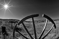 Wagon Wheel and Sunburst in Bodie State Park in California. Image taken with a Nikon D700 and 16 mm f/2.8 fisheye lens (ISO 200, 16 mm, f/22, 1/125 sec). Converted to B&W with Nik Silver Efex Pro.