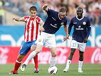 Atletico de Madrid's Gabi against Stromsgodset's Jo Inge Berget during UEFA Europa League third qualifying round match. July 28, 2011. (ALTERPHOTOS/Alvaro Hernandez)