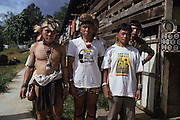 LOGGING & INDIGENOUS DAYAKS, MALAYSIA. Sarawak, Borneo, South East Asia. Along Sega (lhs) Penan, Kelabit Jangin Taibilung, and Penan Aweng, all three activists fighting for landrights issues in the face of commercial logging, 1989 <br /> <br /> Tropical rainforest and one of the world's richest, oldest eco-systems, flora and fauna, under threat from development, logging and deforestation. Home to indigenous Dayak native tribal peoples, farming by slash and burn cultivation, fishing and hunting wild boar. Home to the Penan, traditional nomadic hunter-gatherers, of whom only one thousand survive, eating roots, and hunting wild animals with blowpipes. Animists, Christians, they still practice traditional medicine from herbs and plants. Native people have mounted protests and blockades against logging concessions, many have been arrested and imprisoned.