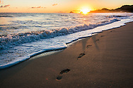 Footprints on the beach at sunrise, Kailua Beach, Oahu, Hawaii