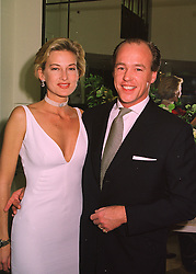 MR & MRS HARRY NUTTALL at a party in London on 29th April 1998.MHG 8