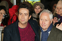 © Licensed to London News Pictures. Radio one DJ Nick Grimshaw and his father Peter Grimshaw, attend The Class of 92  World Film Premiere at The Odeon West End, Leicester Square, London on 01 December 2013. Photo credit: Richard Goldschmidt/LNP