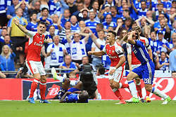 27 May 2017 - Then FA Cup Final - Arsenal v Chelsea - Granit Xhaka and Alexis Sanchez of Arsenal reacts as Victor Moses of Chelsea rolls on the pitch before being sent off - Photo: Marc Atkins / Offside.