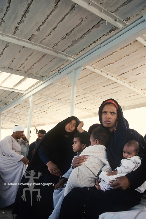 Egyptian family in ferry boat crossing the Nile, Luxor, Egypt