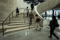 © Licensed to London News Pictures. 14/06/2016. London, UK. Visitors wander up a staircase in the Switch House, the new Tate Modern building which opens to the public on Friday 17 June 2016. The ten-storey extension was designed by architects Herzog & de Meuron and includes the world's first gallery space dedicated exclusively to live art, film and installations. Photo credit: Rob Pinney/LNP