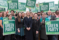 © Licensed to London News Pictures. 06/11/2019. Bristol, UK. General Election 2019; Centre left-right: AMELIA WOMACK deputy leader of the Green Party, SIAN BERRY co-leader of the Green Party, CARLA DENYER Green parliamentary candidate for Bristol West. The Green Party's national campaign event at We The Curious in Bristol Harbourside on the day of the official start of the general election campaign 2019. The Green Party are targeting the seat of Bristol West where the Labour MP Thangam Debbonaire has a large majority but where the Green candidate came first in the elections for the European Parliament. Photo credit: Simon Chapman/LNP.
