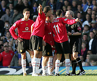 Fotball<br /> Premier League England 2004/2005<br /> Foto: SBI/Digitalsport<br /> NORWAY ONLY<br /> <br /> 30.10.2004<br /> Portsmouth v Manchester United<br /> <br />  Manchester's Wayne Rooney gets a yellow card. which is disputed by his team.