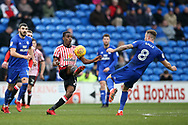 Joel Asoro of Sunderland is challenged by Joe Ralls of Cardiff city.  EFL Skybet championship match, Cardiff city v Sunderland at the Cardiff city stadium in Cardiff, South Wales on Saturday 13th January 2018.<br /> pic by Andrew Orchard, Andrew Orchard sports photography.