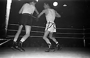 25/01/1963<br /> 01/25/1963<br /> 25 January 1963<br /> National Junior Boxing Championships at the National Stadium, Dublin. Picture shows S. McCafferty (left) of the St. John Bosco Boxing Club, Belfast, trading blows with G. Deegan of St. Matthews B.C., Belfast in their Flyweight Final at the National Stadium.
