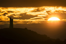 July 31, 2017 - Huddersfield, Yorkshire, UK - Huddersfield UK. The sun rises this morning behind Victoria Tower on Castle Hill in Huddersfield. The tower was built in 1899 to celebrate 60 years old Queen Victoria's reign & sit's 1000ft above sea level. (Credit Image: © Andrew Mccaren/London News Pictures via ZUMA Wire)