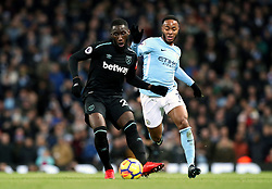 West Ham United's Arthur Masuaku (left) and Manchester City's Raheem Sterling (right) battle for the ball during the Premier League match at the Etihad Stadium, Manchester.