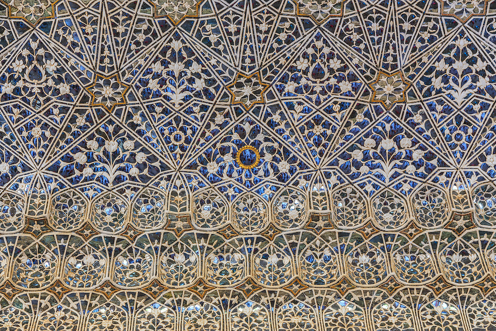 Ornaments in Sheesh Mahal (Glass Palace) in Amer Fort in Jaipur, India.