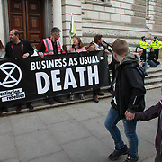 A number of activists have super glued themselves together blocking the entrance to the Treasuary  in protest against their lack of climate change action. No arrests were made. The environmental protest group Extinction Rebellion has called for civil disobedience and peaceful protest to force the British government to take drastic action on climate change. For up to ten days Extinction Rebellion activists occupied Waterloo Bridge, Parliament Square, Oxford Circus and Marble Arch disrupting traffic and 'normal life'. More than a thousand people were arrested before the police finally cleared the street and the International Rebellion was called to halt by the the activists.  The group wants the government to tell the truth and admit that the impact of climate change is much more severe than they say and that action to mitigate catastrophic climate change is urgent.