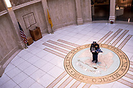 U.S. Marine Corps and Vietnam War veteran Manuel Valenzuela stands on the rotunda floor of the New Mexico State Capitol Building as he holds an American flag and a framed photograph of his mother in Sante Fe, New Mexico, Monday, September 24, 2018.<br /> <br /> Valenzuela and his older brother Valente, a U.S. Army and Vietnam War veteran, have been fighting deportation since 2009 for misdemeanor offenses which they completed sentences for. Their birth certificates classify them as resident aliens since their mother, a native from New Mexico, gave birth to them in México. Their deportation cases have been lingering in the courts. They might qualify as U.S. citizens as a result of their mother's citizenship status.