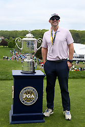 May 19, 2019 - Bethpage, New York, United States - Former baseball player David Wright poses with the Wanamaker trophy on the first tee during the final round of the 101st PGA Championship at Bethpage Black. (Credit Image: © Debby Wong/ZUMA Wire)