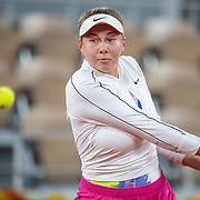 PARIS, FRANCE October 02. Amanda Anisimova of the United States  in action against Simona Halep of Romania in the third round of the singles competition on Court Philippe-Chatrier during the French Open Tennis Tournament at Roland Garros on October 2nd 2020 in Paris, France. (Photo by Tim Clayton/Corbis via Getty Images)