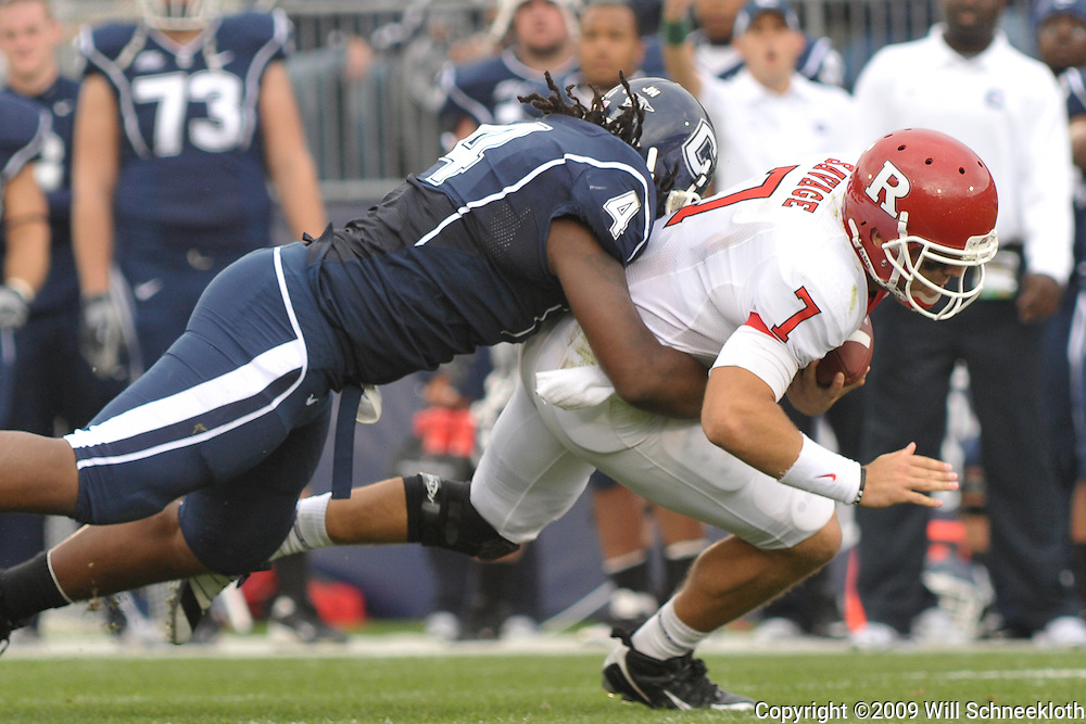 Oct 31, 2009; East Hartford, CT, USA; Connecticut defensive tackle Twyon Martin (4) tackles a scrambling Rutgers quarterback Tom Savage (7) during second half Big East NCAA football action in Rutgers' 28-24 victory over Connecticut at Rentschler Field.