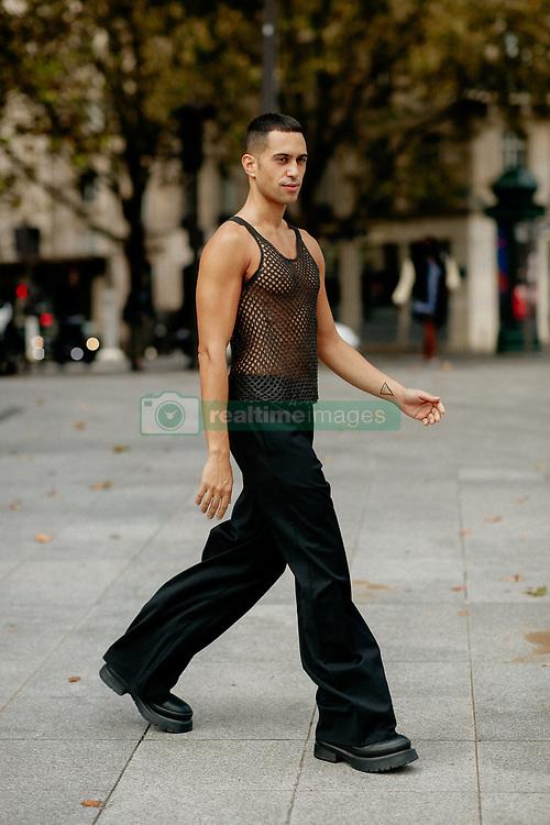 Street style, Mahmood arriving at Ludovic de Saint Sernin Spring Summer 2022 show, held at Institut du Monde Arabe, Paris, France, on Ocotber 3rd, 2021. Photo by Marie-Paola Bertrand-Hillion/ABACAPRESS.COM