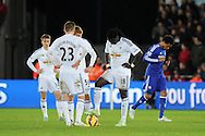 Swansea players look dejected as they prepare to restart after conceding a 5th goal. Barclays Premier League match, Swansea city v Chelsea at the Liberty Stadium in Swansea, South Wales on Saturday 17th Jan 2015.<br /> pic by Andrew Orchard, Andrew Orchard sports photography.