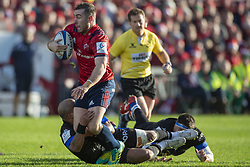 December 9, 2018 - Limerick, Ireland - JJ Hanrahan of Munster tackled by Jody Jenneker of Castres during the Heineken Champions Cup Round 3 match between Munster Rugby and Castres Qlympique at Thomond Park Stadium in Limerick, Ireland on December 9, 2018  (Credit Image: © Andrew Surma/NurPhoto via ZUMA Press)