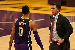 February 27, 2019 - Los Angeles, CA, U.S. - LOS ANGELES, CA - FEBRUARY 27: Lakers coach Luke Walton chats with Los Angeles Lakers Forward Kyle Kuzma (0) during the first half of the New Orleans Pelicans versus Los Angeles Lakers game on February 27, 2019, at Staples Center in Los Angeles, CA. (Photo by Icon Sportswire) (Credit Image: © Icon Sportswire/Icon SMI via ZUMA Press)