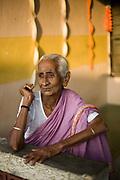 Sagunthala outside her room at the Tamaraikulum Elders's Village, Cuddalore, Tamil Nadu, India