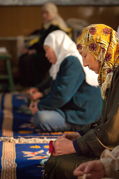 Women pray at a the at the Wangjia Hutong Women's Mosque in Kaifeng, Henan province, China. There are 16 women's mosques in the city, one-third the number of mosques serving male Muslims.
