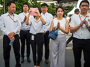 21 AUGUST 2015 - BANGKOK, THAILAND: Thais participate in the prayer service at Central World to honor the dead from the Erawan Shrine bombing. The Bangkok Metropolitan Administration (BMA) held a religious ceremony Friday for the Ratchaprasong bomb victims. The ceremony started with a Brahmin blessing at Erawan Shrine, which was the target of a bombing Monday night. After the blessing people went across the street to the plaza in front of Central World mall for an interfaith religious service. Theravada Buddhists, Mahayana Buddhists, Muslims, Sikhs, Hindus, and Christians participated in the service. Life at the shrine, one of the busiest in Bangkok, is returning to normal. Friday the dancers and musicians who perform at the shrine resumed their schedules.       PHOTO BY JACK KURTZ