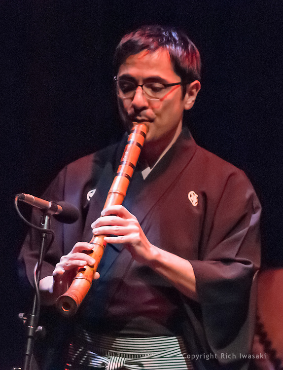 """Musician Araki Kodo VI plays the shakuhachi at Portland Taiko concert """"Three: 3 conversations with Taiko"""", Winningstad Theatre, Portland Center for the Performing Arts, Portland, Oregon. He is the world's only 6th-generation shakuhachi player."""